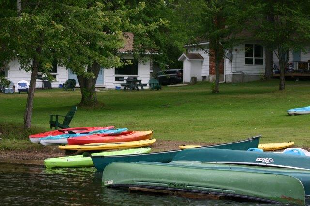 boats in front of cottages